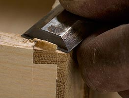 Hand finishing a drawer joint